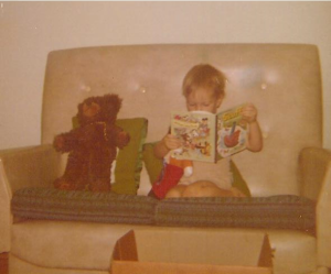 Rob reading to his toys at age two